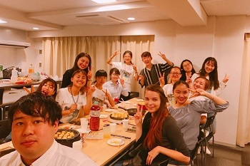 International students, buddies, and dormitory residents interacting at OIC International House