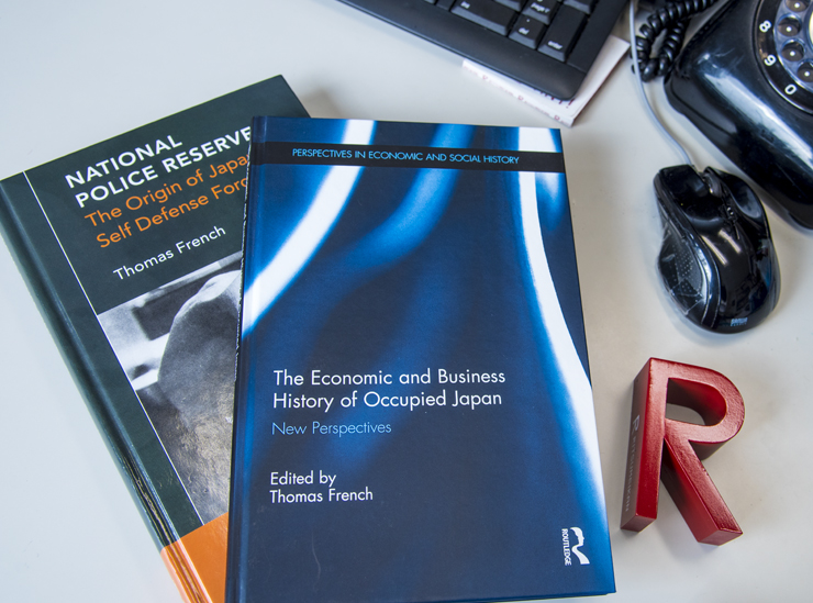 Professor French - two publications laid on the professors desk with a Ritsumeikan R mark book end