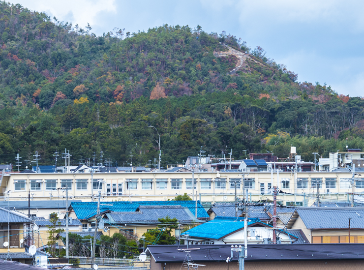 Professor French's research building looks out on one side to views of Daimonji Mountain. The Japanese character for 'large' can be seen on the mountain – one of the sites for the famous Daimonji Festival.
