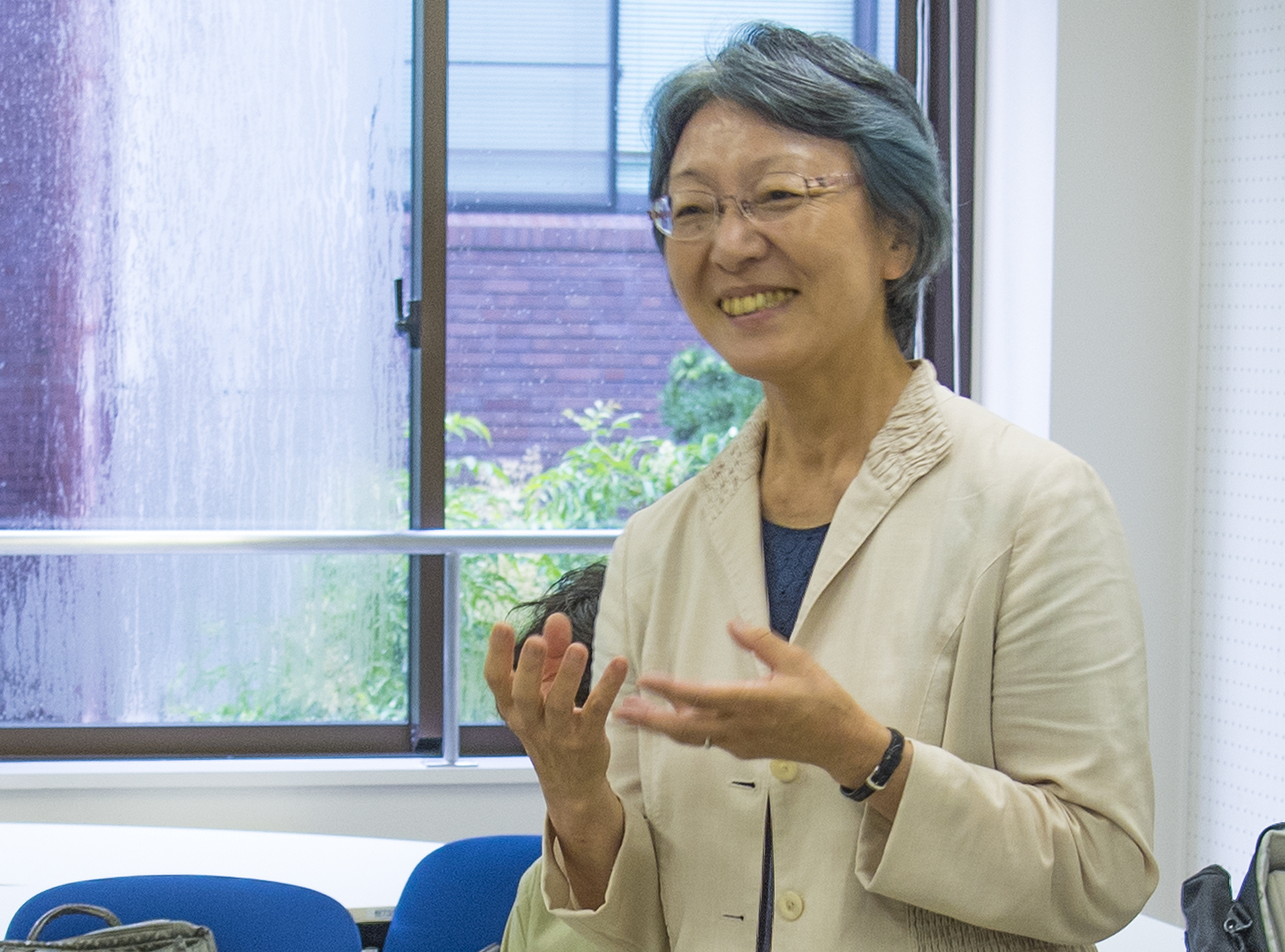 The first female dean of the College of International Relations at Ritsumeikan University smiles broadly